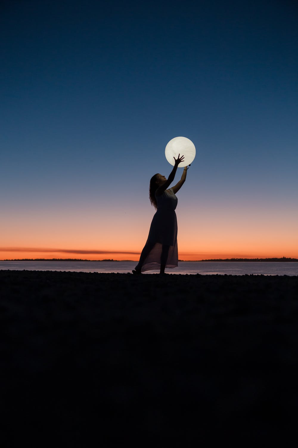 Girl holding the moon