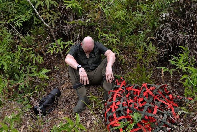 Craig Jones Wildlife Photography. Craig sits devastated after seeing the destruction of Sumatra's rainforests